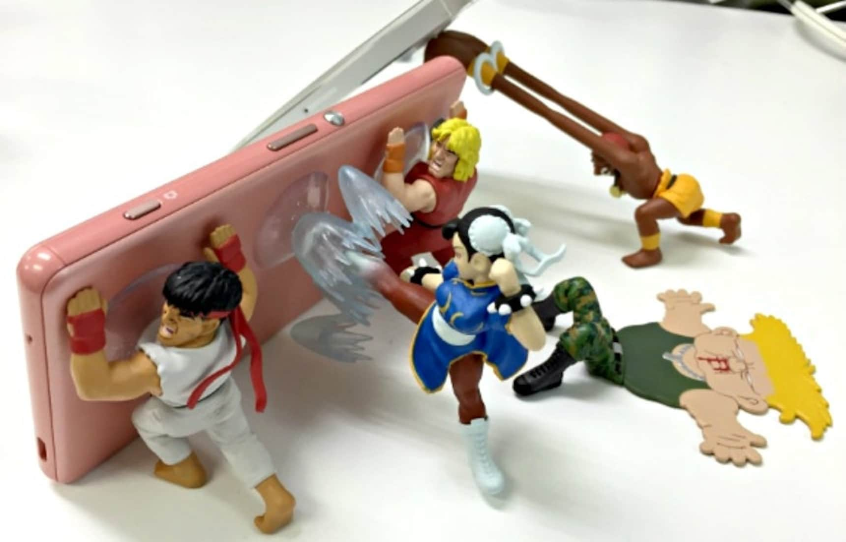 KO Your Smartphone with these Toy Stands