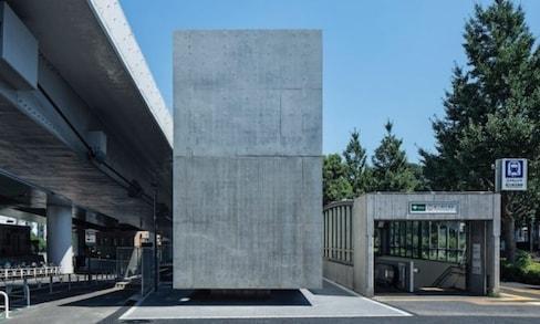 Floating Concrete Block Hides Stylish Restroom