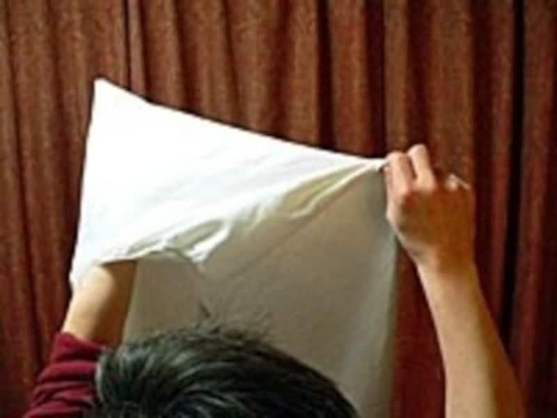 ボックスシーツのたたみ方手順3:これで片方の短い辺がきれいに収まる