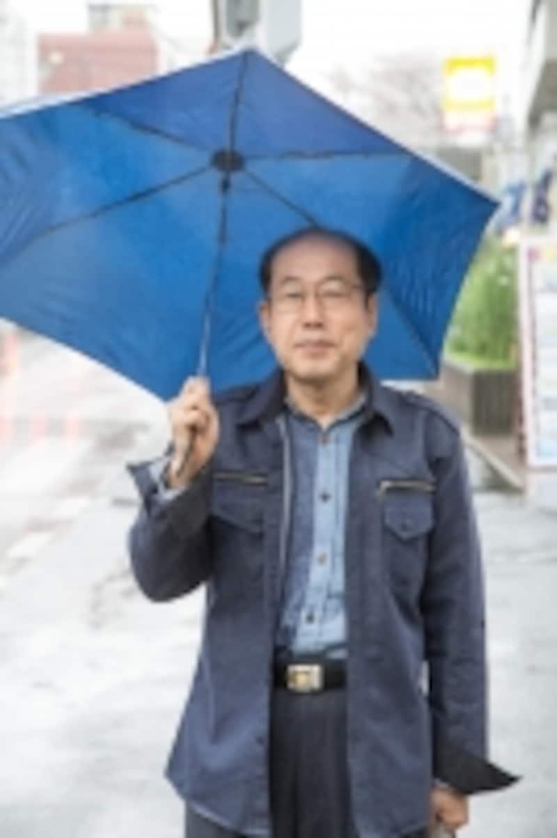 雨の日の取材。今日は自転車には乗れなかったが、折りたたみ傘も優待品としてゲットしたという