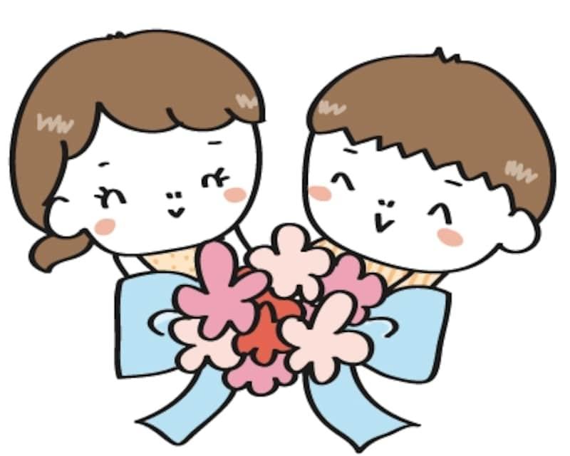【カラー】お祝いの花束をもった子どもたちです。