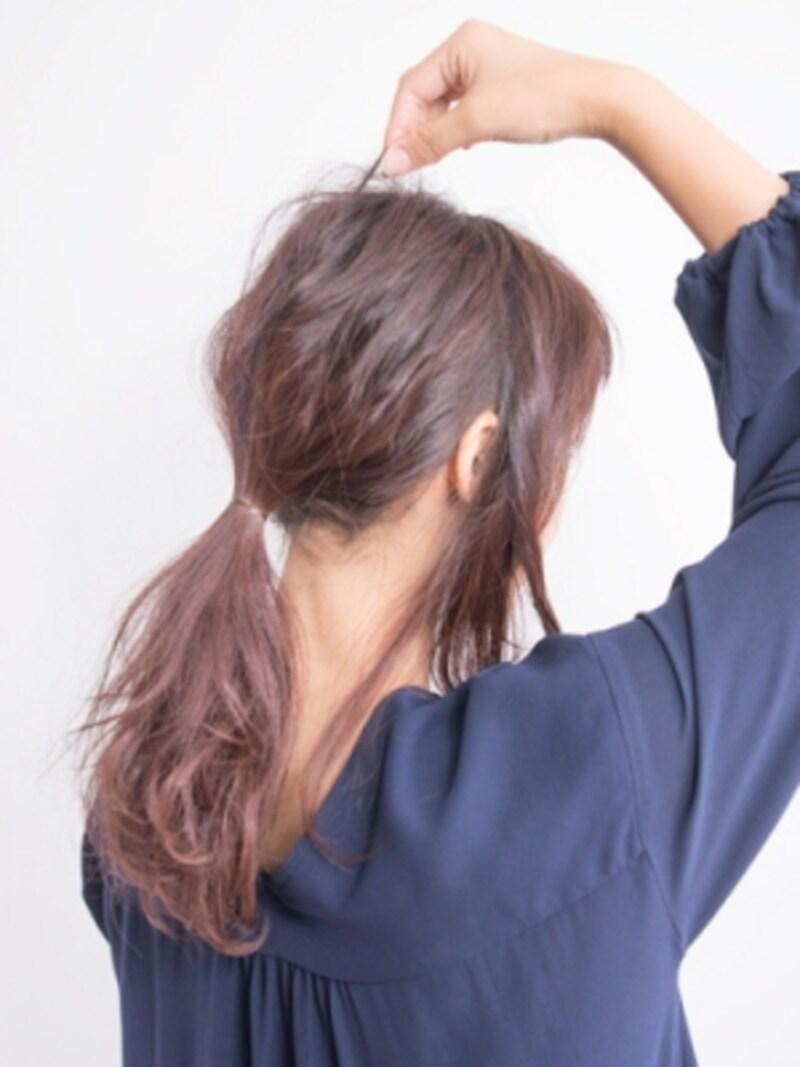 表面の毛を指先でつまむようにして引き出す