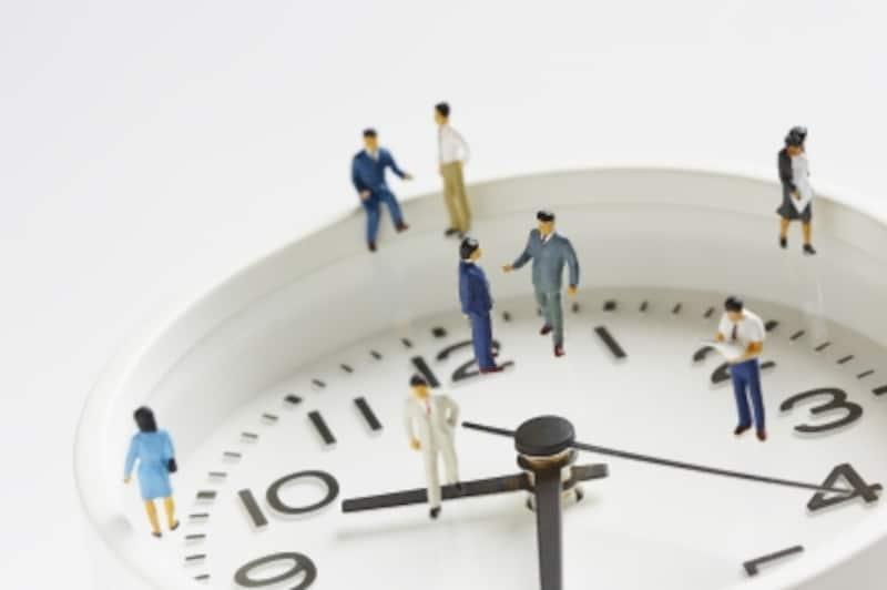 時計の上で働く人々