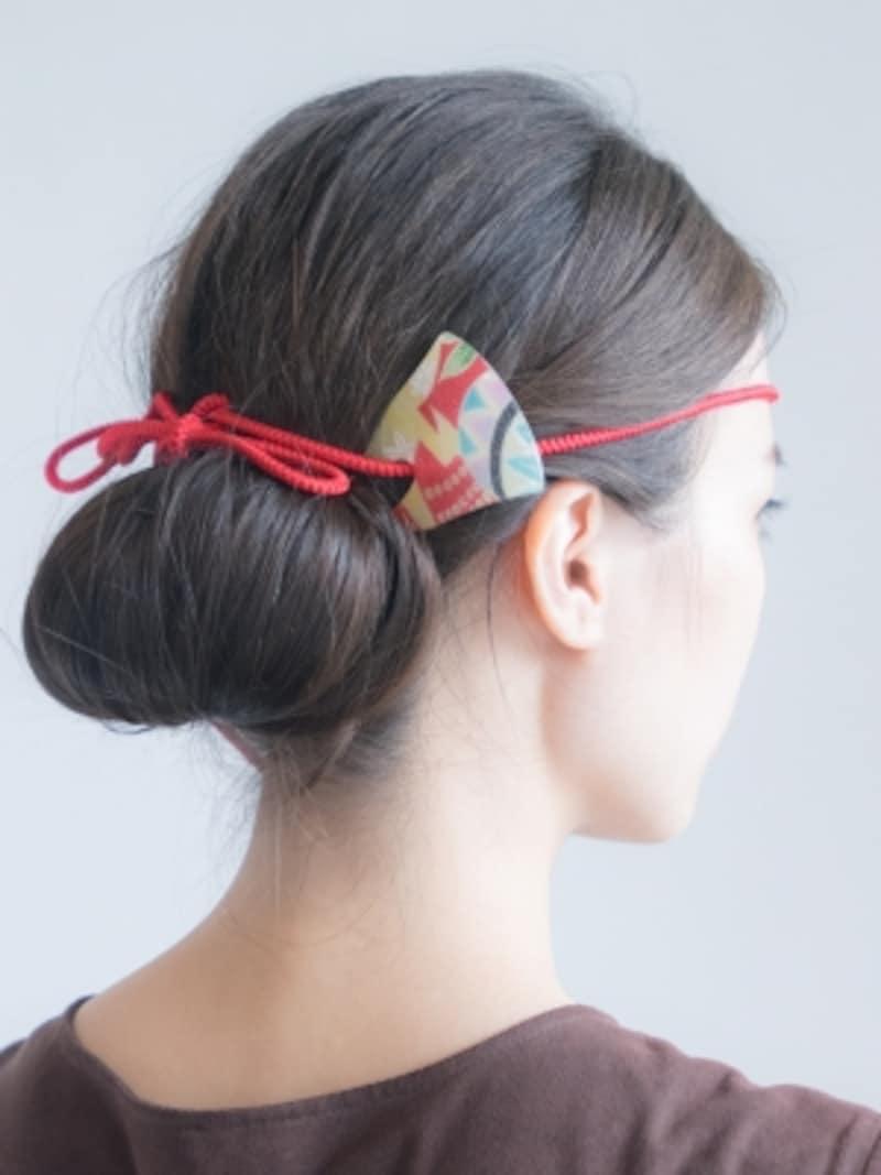 紐を結んでからかんざしを挿したお祭りヘア