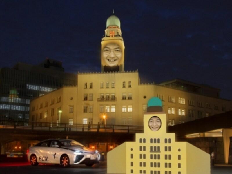メイン作品は「顔はめ看板」をモチーフとした高橋匡太さんの作品《カオハメ・ザ・ワールド》。象の鼻パークに設置された「顔はめ看板」から参加者が顔を出すと、その笑顔が横浜税関の建物壁面にプロジェクションされます(画像提供:スマートイルミネーション横浜実行委員会)