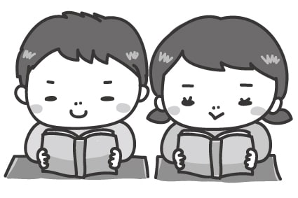 【モノクロ】張り切って教科書を読む子どもたちです。