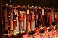 ある日の舞台裏側。ステージ衣装が所狭しと並ぶ