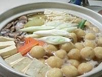 豆腐、エノキ、長ネギを加える