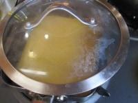 ふたをのせ、卵が固まるまで焼く